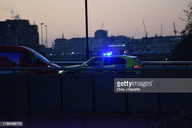 Police car is seen on London Bridge after a number of people are believed to have been injured due to a stabbing, police have said, on November 29,...
