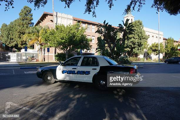 A police car is seen outside Hamilton High School following an 'unspecified threat' to Los Angeles Unified School District schools in Los Angeles...