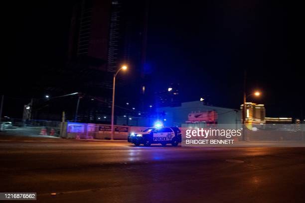 Police car makes its way to the scene after a shooting was reported outside Circus Circus hotel and casino, on June 1 in downtown Las Vegas, at the...