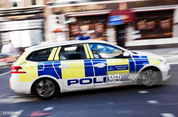 Police car on an emergency call races along Bloomsbury Way in London, England, on May 20, 2020. British Prime Minister Boris Johnson today announced...