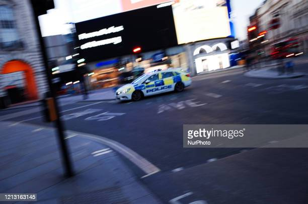 Police car on an emergency call races through a near-deserted Piccadilly Circus in London, England, on May 15, 2020. Nearly eight full weeks have now...