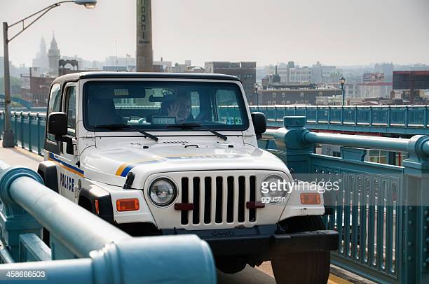 police car on ben franklin bridge in philadelphia, pennsylvania - philadelphia police car stock pictures, royalty-free photos & images