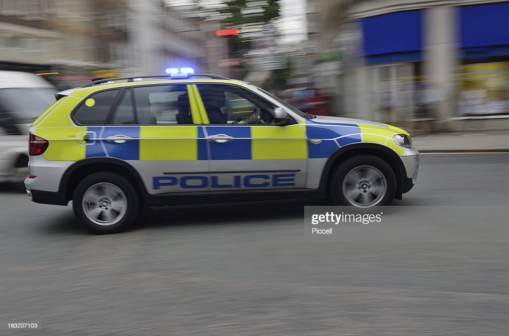 Police car on signal, blurred motion : Stock Photo