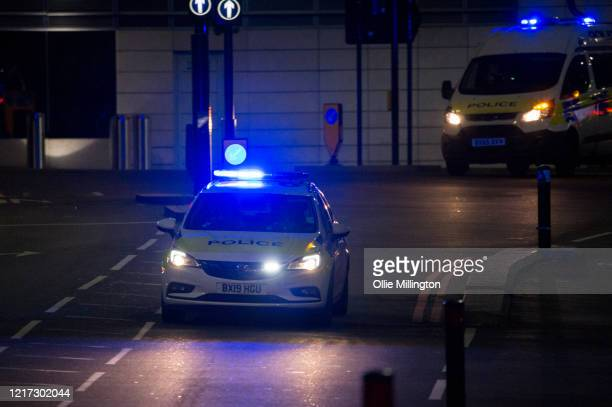 Police car outside St Thomas Hospital in Westminster, where British Prime Minister Boris Johnson has now been transferred to the ICU after showing...