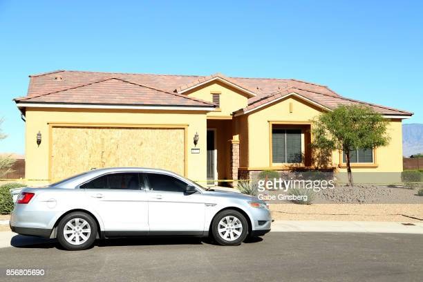 A police car parked in front of the house in the Sun City Mesquite community where suspected Las Vegas gunman Stephen Paddock lived October 2 2017 in...
