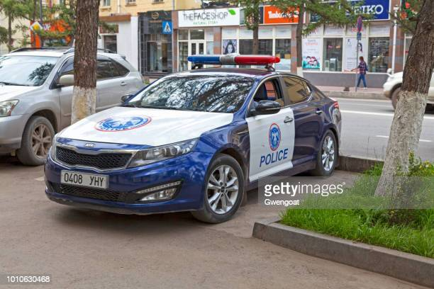 police car parked in ulan bator - gwengoat stock pictures, royalty-free photos & images