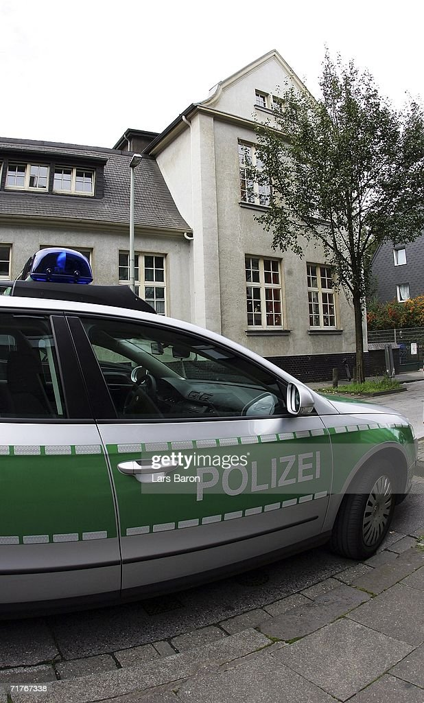 A police car parks in front of the elementary school in Duisburg's Dislichstrasse on September 01, 2006, Duisburg-Meiderich, Germany. On the evening of August 31, 2006 a nine year old schoolgirl was wounded as she played in the schoolyard with other pupils, children heard two shoots fired. The police are tracing a suspect, a former teacher living opposite the school.