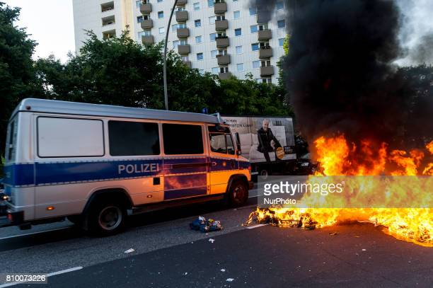 A police car passes a burning barricade The police stopped the leftradical demonstration quotG20 Welcome to Hellquot and triggered the demonstration...