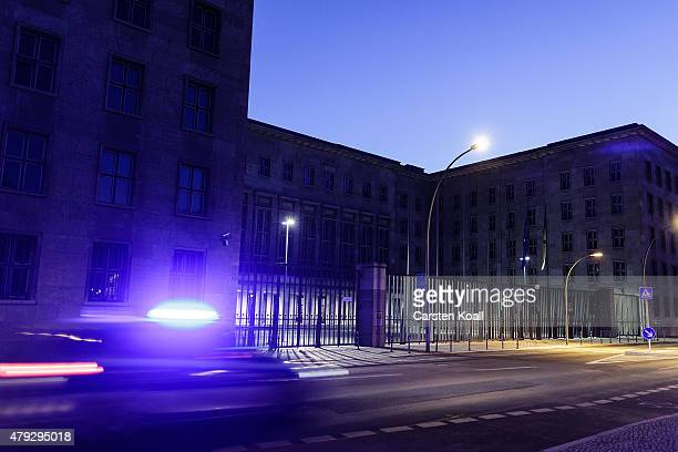 A police car passes the German Federal Ministry of Finance illuminated at dusk on July 2 2015 in Berlin Germany The online whistleblower platform...