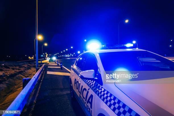 police car patrol on road of madrid during night - força policial imagens e fotografias de stock
