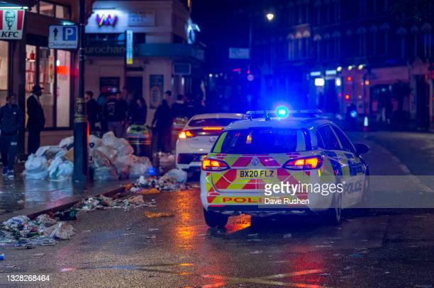 Police car patrols along a street on July 12, 2021 in London, England. Italy's men's team claimed victory over England in the UEFA EURO 2020 final at...