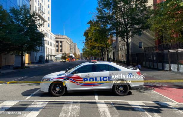 Police car patrols at an empty H street, NW near the White House on November 4, 2020 in Washington, DC. - US President Donald Trump alleged on...