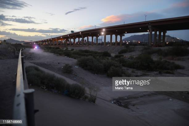A police car patrols in the distance on the Mexican side of the USMexico border on June 27 in Ciudad Juarez Mexico The Mexican government has...