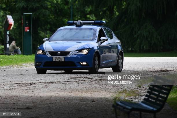 Police car patrols in the Parco Sempione park on May 4, 2020 in Milan as Italy starts to ease its lockdown, during the country's lockdown aimed at...