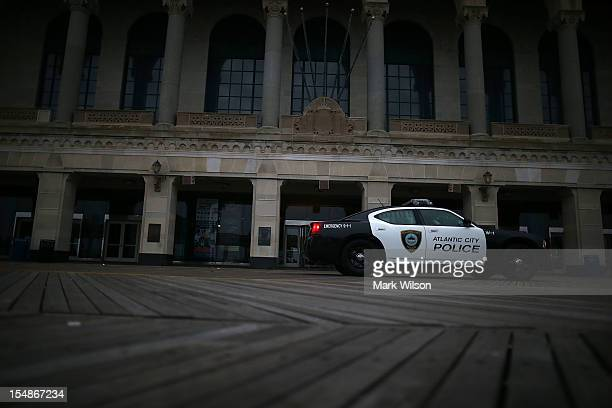 Police car patrols the boardwalk in front of the old Convention Center as Hurricane Sandy approaches on October 28, 2012 in Atlantic City, New...