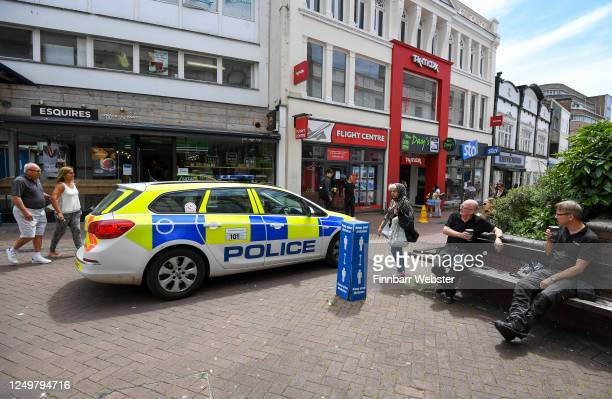 Police car patrols the high street as people shop in the town centre on June 15, 2020 in Bournemouth, United Kingdom. The British government have...