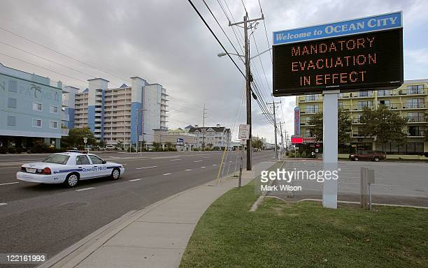 A police car patrols the streets on August 26 2011 in Ocean City Maryland Ocean City Mayor Rick Meehan has ordered a mandatory evacuation for...