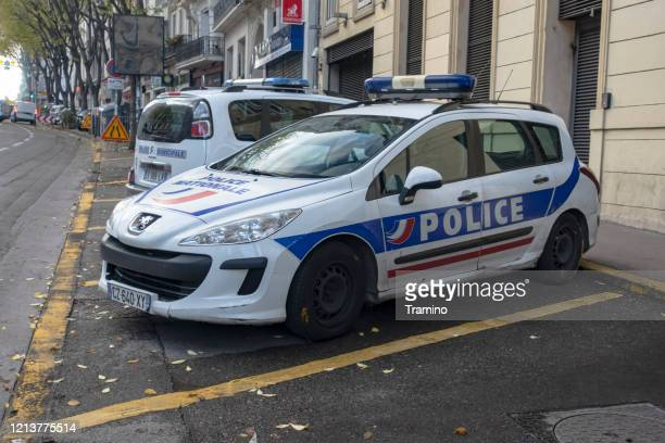 police car peugeot 307 sw on a street - brand name stock pictures, royalty-free photos & images