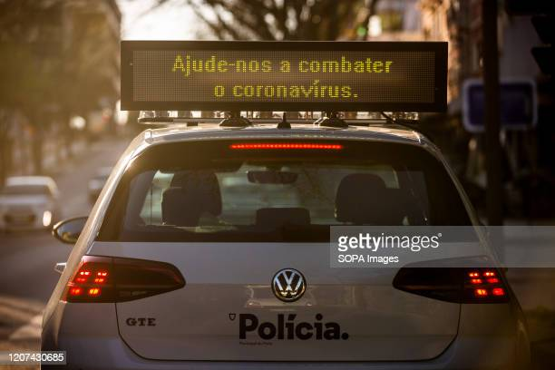 A police car seen with a sign advising people to stop the coronavirus by staying at their homes in the city of Porto The Minister of Health Marta...