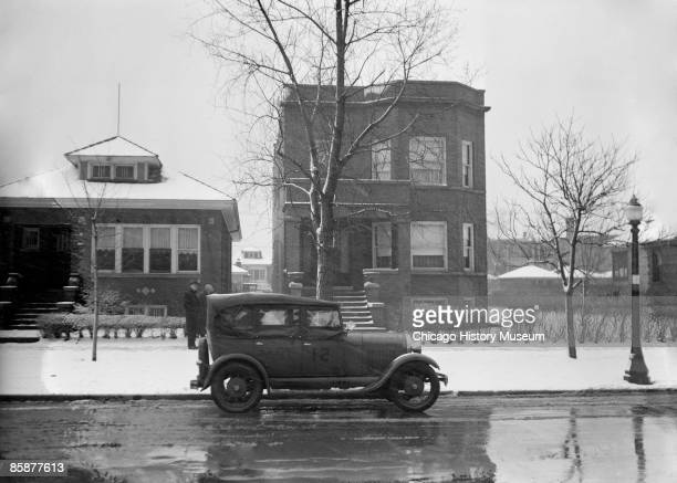 Police car sits outside Al Capone's house, located at 7244 Prairie Avenue in Chicago, ca.1920s.