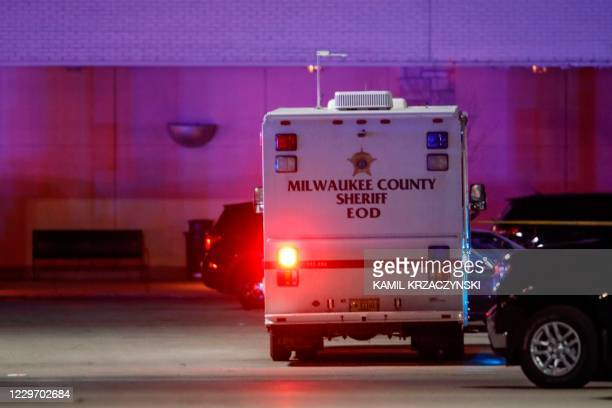 Police car sits outside the Mayfair Mall in Wauwatosa, Wisconsin, on November 20, 2020. - Multiple people were injured in a shooting at the US mall...