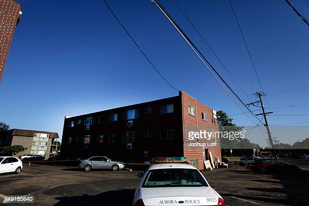 A police car sits parked outside the apartment building where suspect James Holmes lived July 24 2012 in Aurora Colorado Holmes is accused of killing...