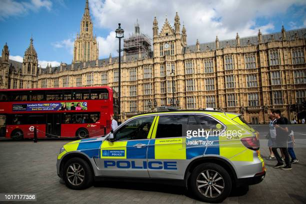 A police car sits parked outside the Houses of Parliament following yesterday morning's incident which is being investigated by terror police on...