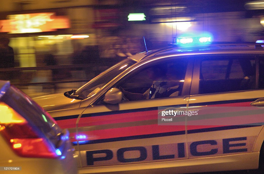 Police car speeding to action in city traffic. : Stock Photo