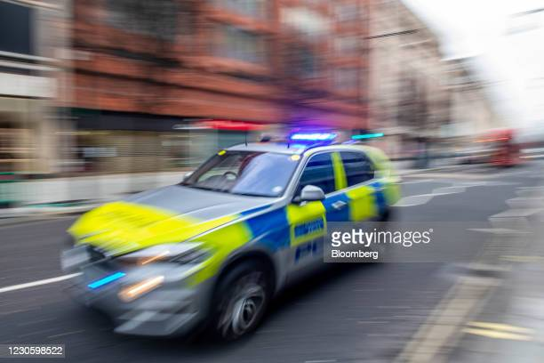 Police car speeds down Oxford Street in London, U.K., on Friday, Jan. 15, 2021. Londoners have received one tenth of all vaccine shots administered...