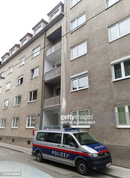 Police car stands in front of a residential building in Sankt Poelten, Austria, where raids were carried out on November 3, 2020 in connection with...