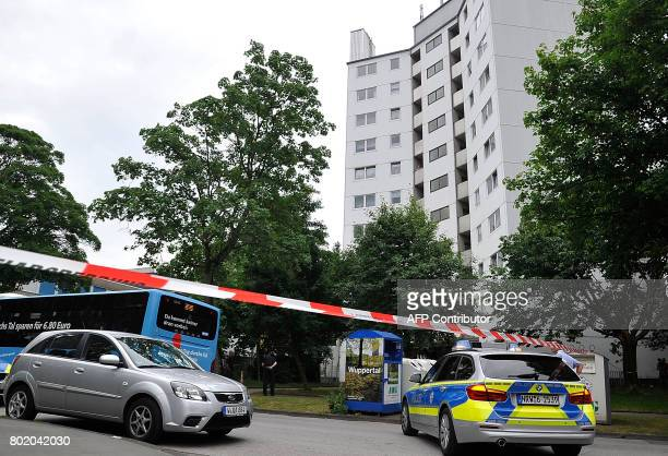 Police car stands in front of a residential building which was evacuated on June 27 2017 in Wuppertal Germany German authorities evacuated a highrise...