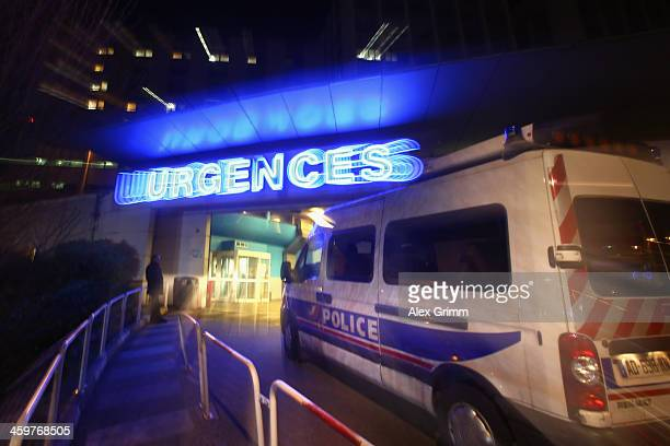 A police car stands in front of the emergency hospitalisation of Grenoble Hospital where former German Formula One driver Michael Schumacher is being...