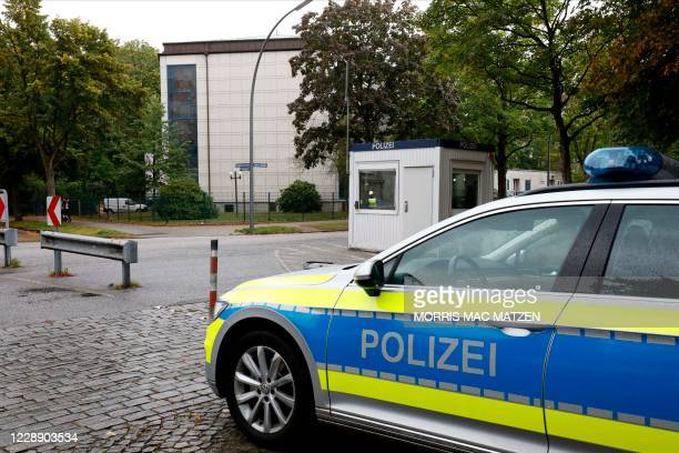 Police car stands in front of the Synagoge 'Hohe Weide' in Hamburg, northern Germany, on Oktober 5 one day after an attack on a Jewish student. - A...
