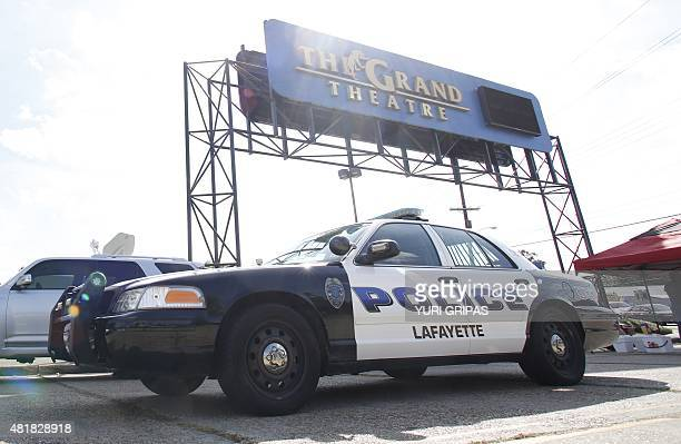 """Police car stands outside The Grand Theatre on July 24, 2015 in Lafayette, Louisiana following the previous night's deadly shooting. A """"drifter"""" with..."""