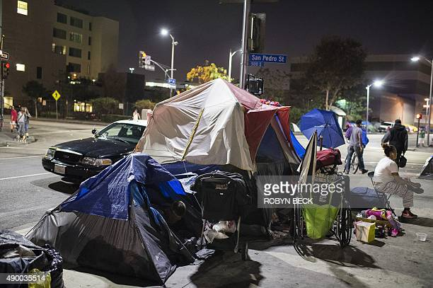 A police car stops beside tents on Skid Row in Los Angles California September 23 2015 Los Angeles elected officials this week declared a...