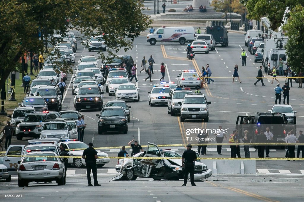 A police car that struck a barricade blocks Constitution Avenue as U.S. Capitol Police investigate a shooting outside of the U.S. Capitol on October 3, 2013 in Washington, DC. Police called the shooting an isolated incident, unassociated with any act of terrorism.