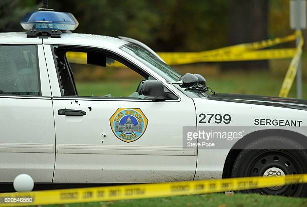 A police car with a broken window sits at the crime scene where a Des Moines police officer was shot and killed in his squad car overnight on...