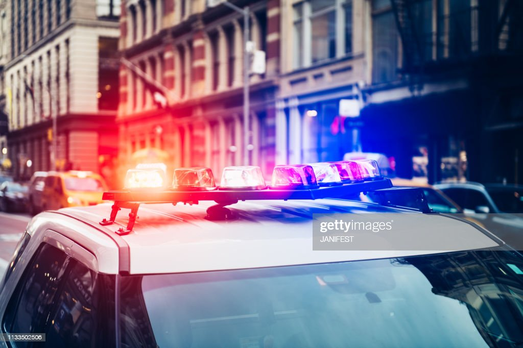 Police car with alarm and signal light flashes on the roof rush emergency call in New York City : Stock Photo