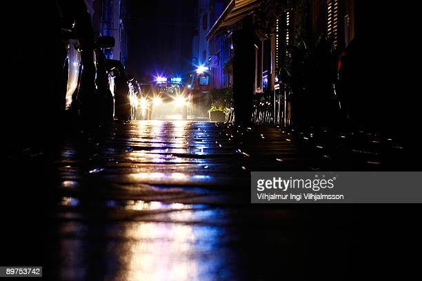 police car with flashing lights at night - police vehicle lighting stock pictures, royalty-free photos & images