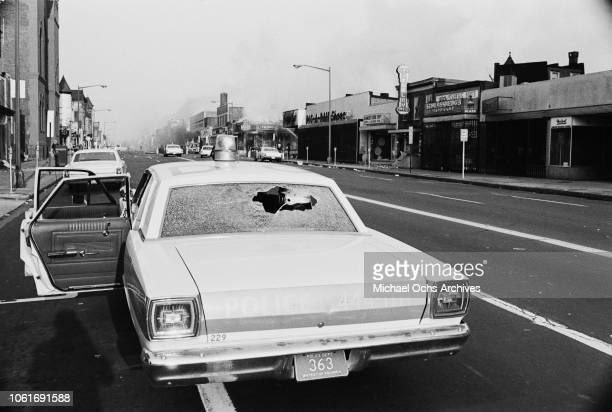 A police car with smashed windows during the riots in Washington DC following the assassination of civil rights activist Martin Luther King Jr April...