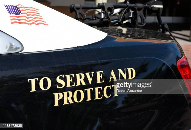 Police car with 'To Serve and Protect' on its side in Santa Fe, New Mexico.