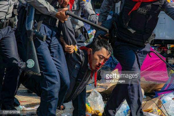 Police carry an injured protester after police cracked down on the military coup protesters. Myanmar police cracks down on thousands of protesters...