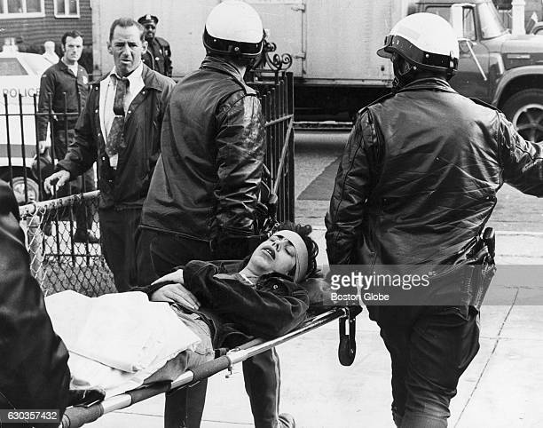 Police carry an unidentified student on a stretcher from Hyde Park High School in Boston to an ambulance on the morning of Oct 15 1974 An initiative...