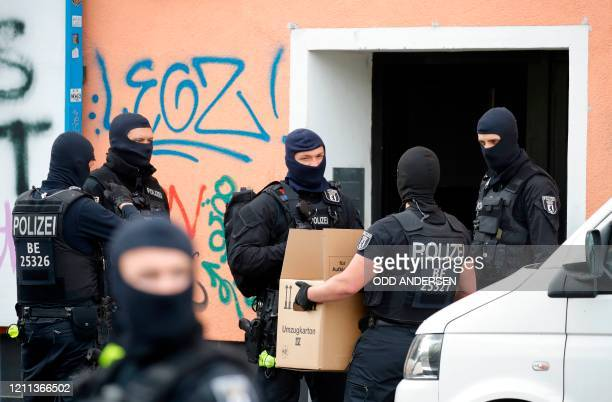 Police carry evidence in a moving box out of AlIrschad Mosque during a raid on April 30 2020 in Berlin as dozens of police and special forces stormed...