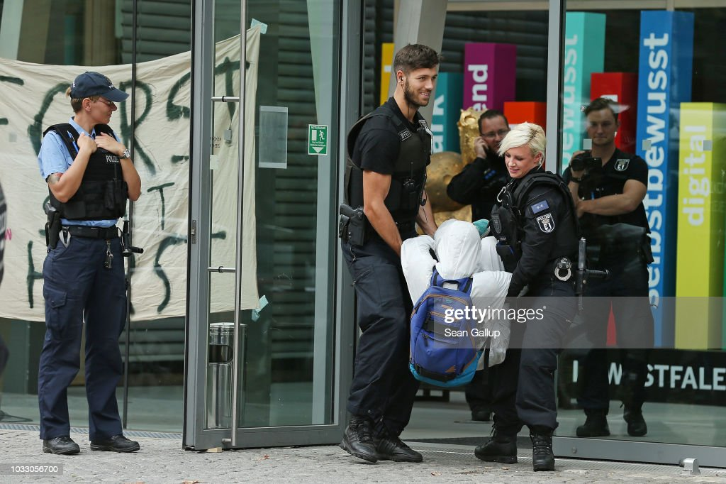 Police carry out an environmental activist from the group 'Ende Gelaende' who, together with colleagues, were occupying the entrance to the state representation of North Rhine-Westphalia on September 14, 2018 in Berlin, Germany. The activists are protesting the ongoing eviction of fellow activists from the Hambacher Forst forest near Cologne who have been seeking to stop the expansion of an adjacent open-pit coal mine.