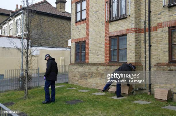 Police carry out searches close to a murder scene on London Road in west Croydon south London after a man was fatally stabbed there shortly after...