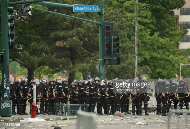 Police carrying batons hold a line on the fourth day of protests on May 29 2020 in Minneapolis Minnesota The National Guard has been activated as...