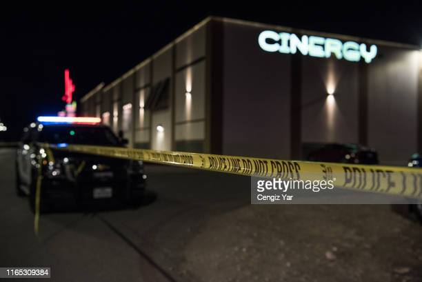 Police cars and tape block off a crime scene outside the Cinergy Odessa movie theater where a gunman was shot and killed on August 31 2019 in Odessa...