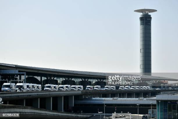 Police cars are lined up outside Charles de Gaulle airport during a strike of Air France employees in Roissy outside Paris on February 22 2018 Half...
