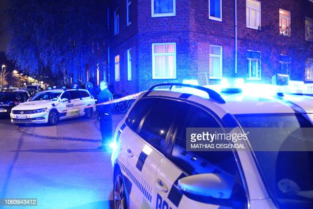 Police cars are parked at the scene where former leader of the gang Los Guerreros in Denmark and cohost at Radio24syv Nedim Yasar was shot dead on...